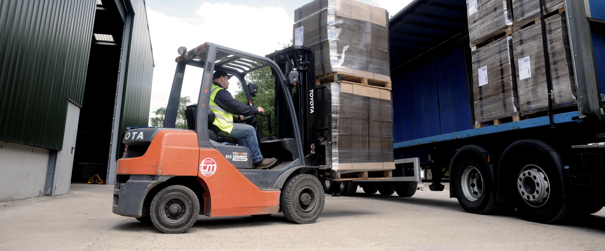The on-site team of our family run business safely unloading pallets into the warehouse