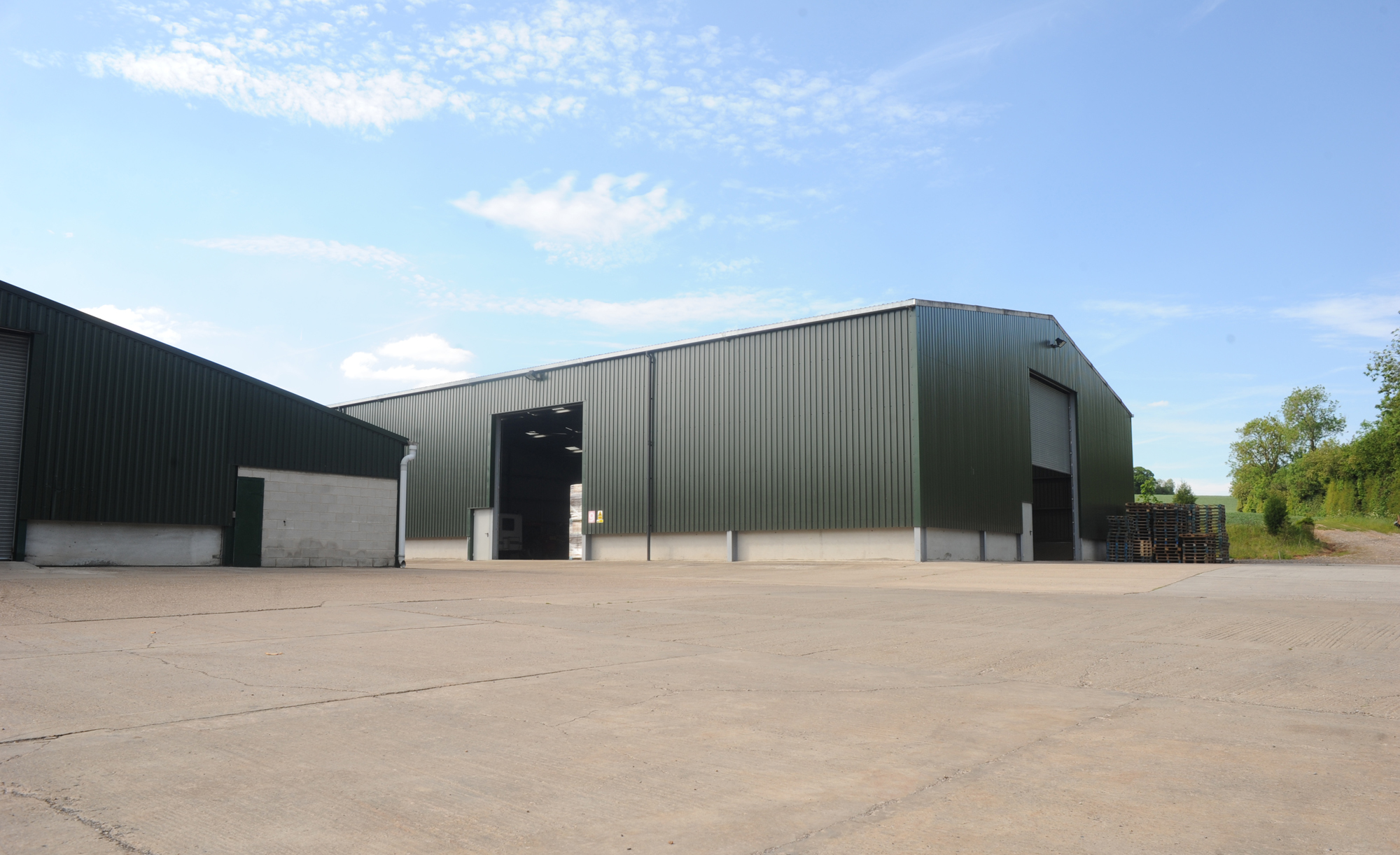 High access warehouse doors and spacious yard for HGVs at bulk pallet storage site